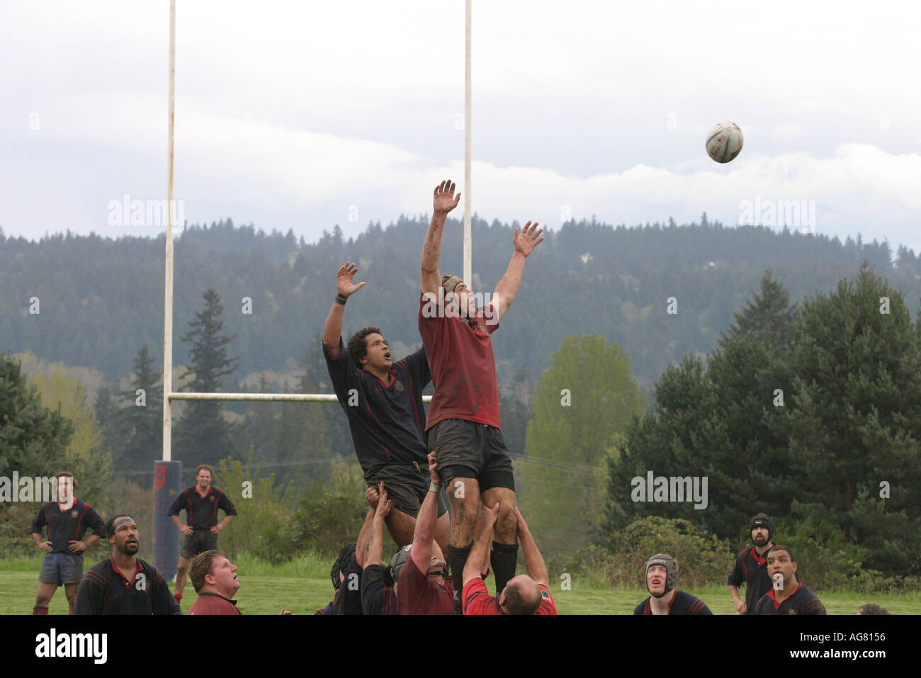 A men s rugby game in action during the scrum as players fight for the ball at a game in Oregon - Stock Image