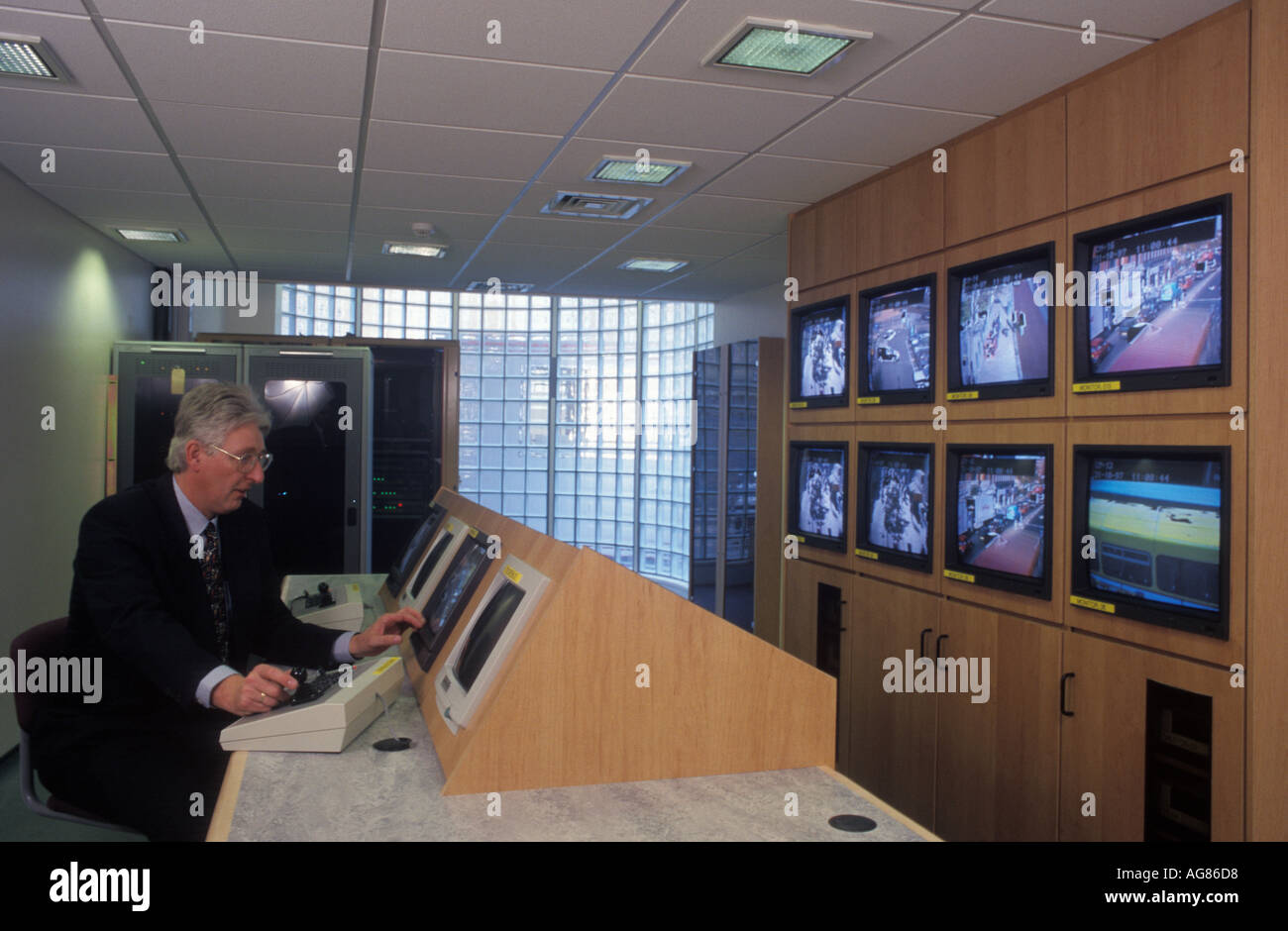 An operator at work in a close circuit television suite in Hackney, London, UK. - Stock Image
