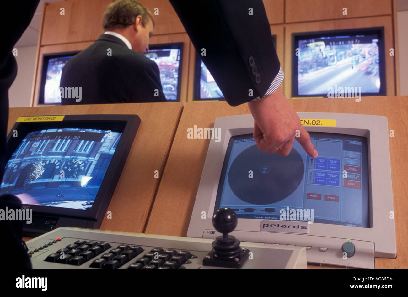 TV screens and security operators at a cctv suite in Hackney, London, UK. - Stock Image