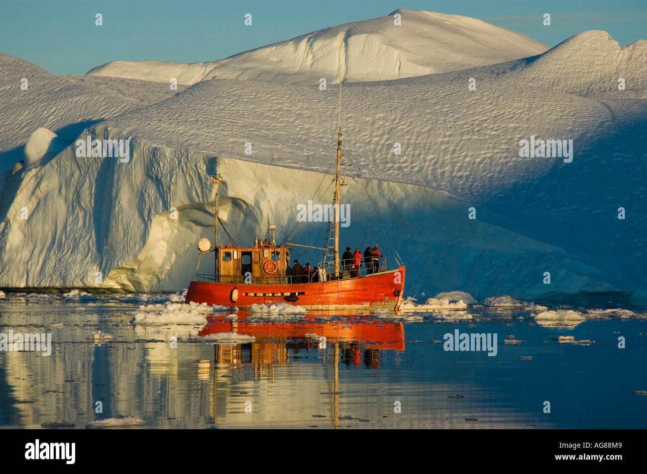 Fishing cutter / fishing smack in Kangia icefjord, Disko Bay, Unesco Nature Heritage, Greenland, Ilulissat, Jakobshavn icefjord - Stock Image