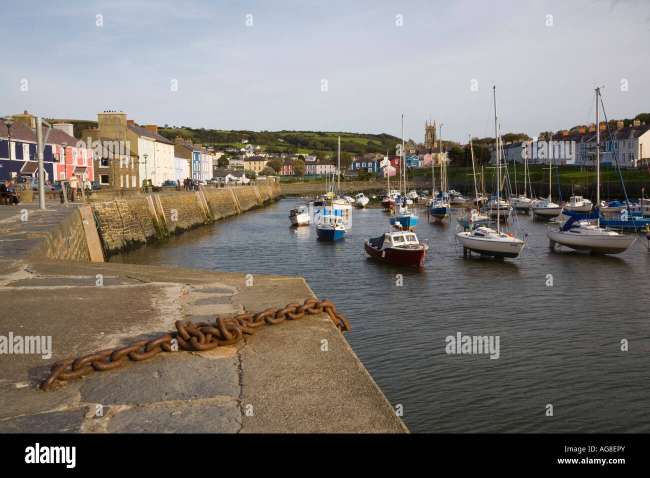 View along harbour with boats moored in attractive seaside town Aberaeron Ceredigion Mid Wales UK - Stock Image