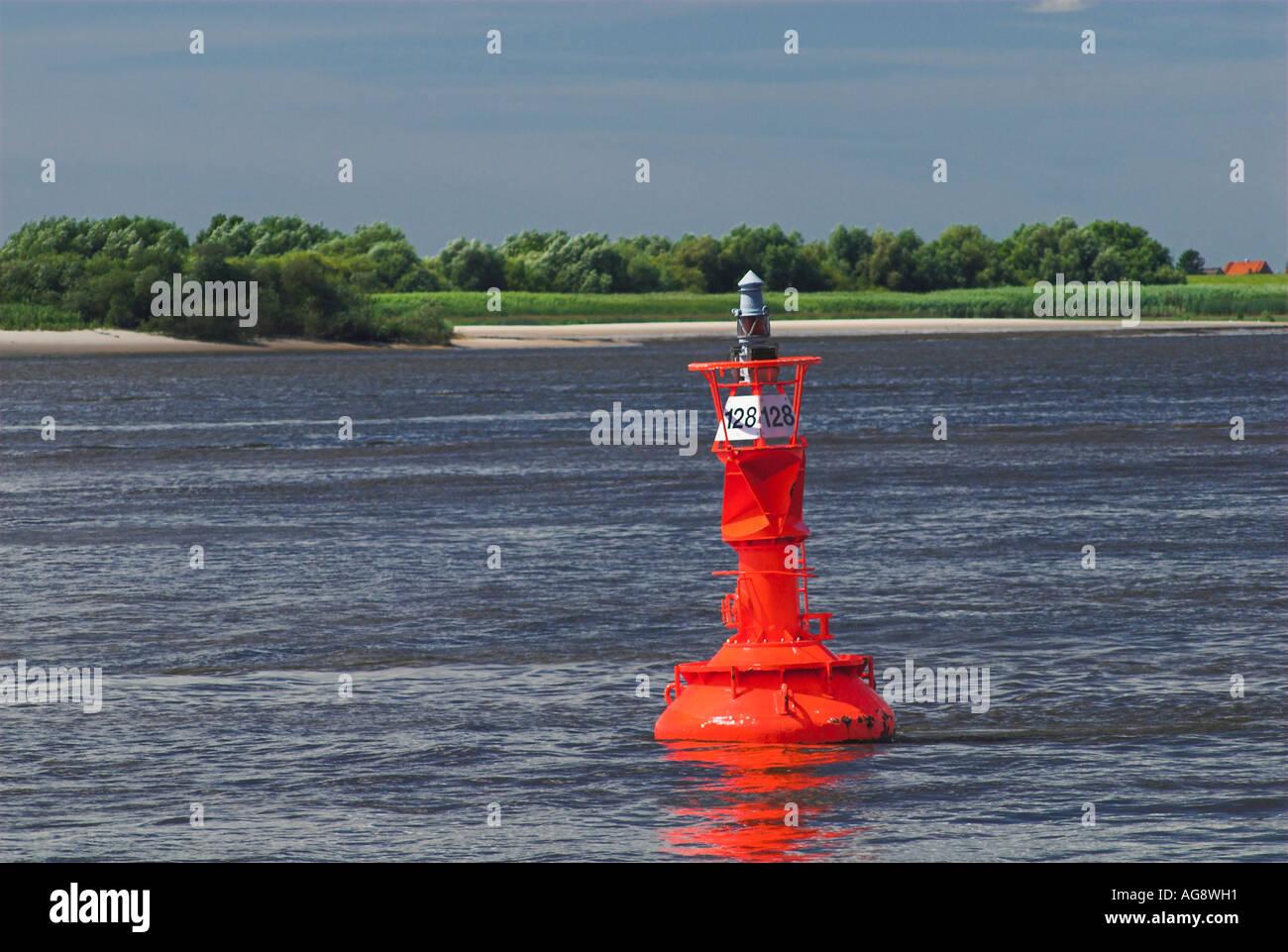 Red fairway buoy at river Elbe near Hamburg, Germany - Stock Image
