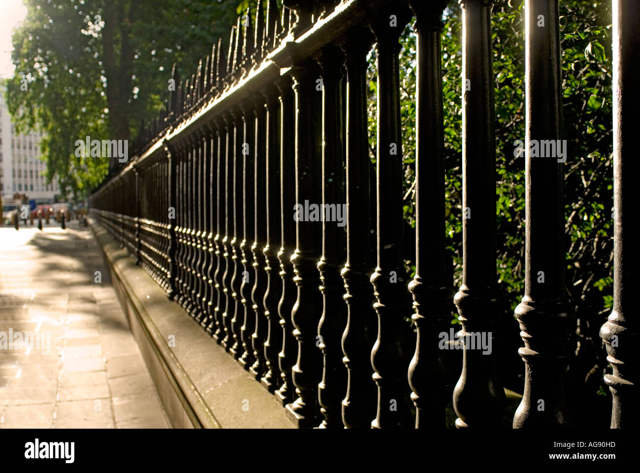 Cast iron railings surrounding the gardens of Saint Pauls Cathedral beside Paternoster Square London England - Stock Image