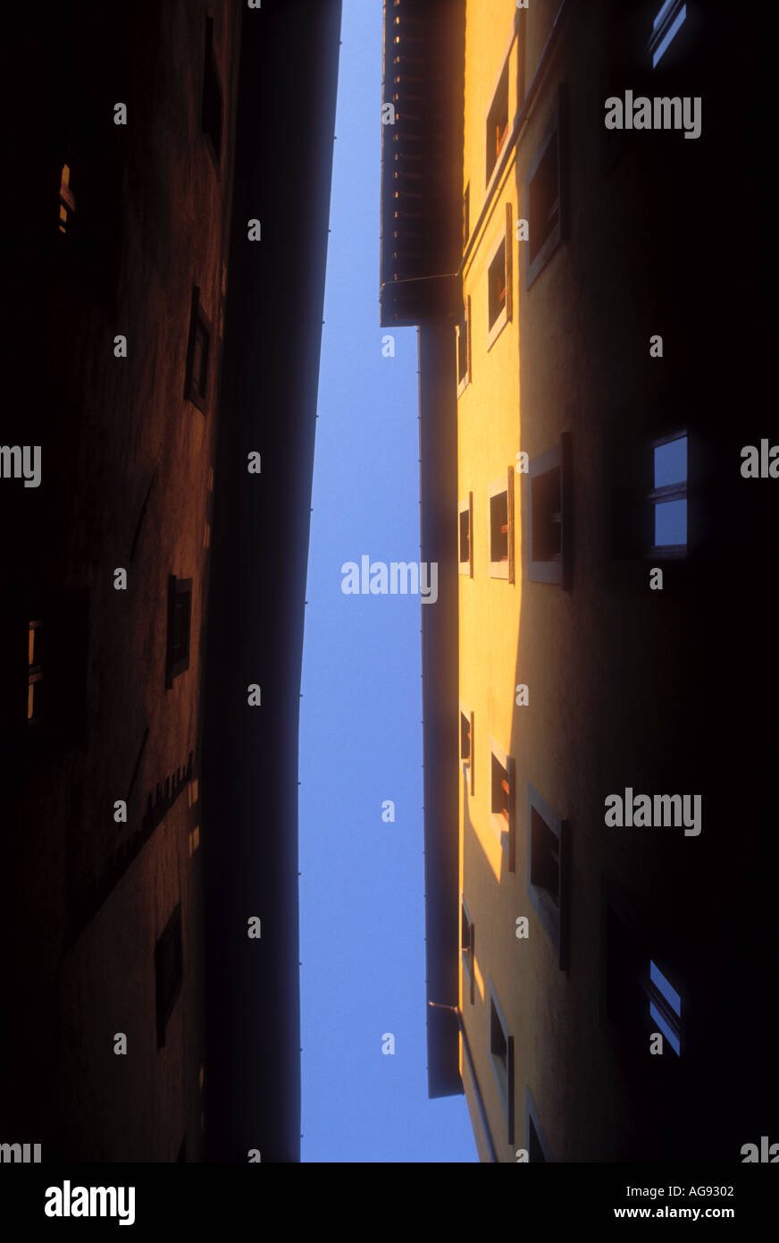 Upward view between buildings in the city of Florence in Italy - Stock Image