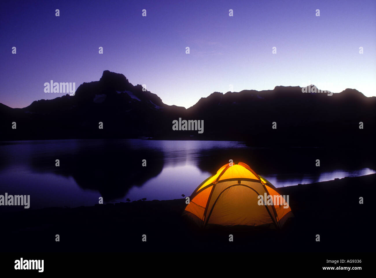 Camping tent beside Thousand Island Lake in the Sierra Nevada Mountains California Property released image - Stock Image