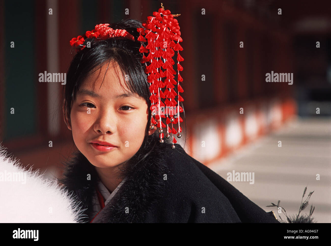 Young Japanese woman dressed up for New Year Yakushiji temple Nara prefecture Japan - Stock Image