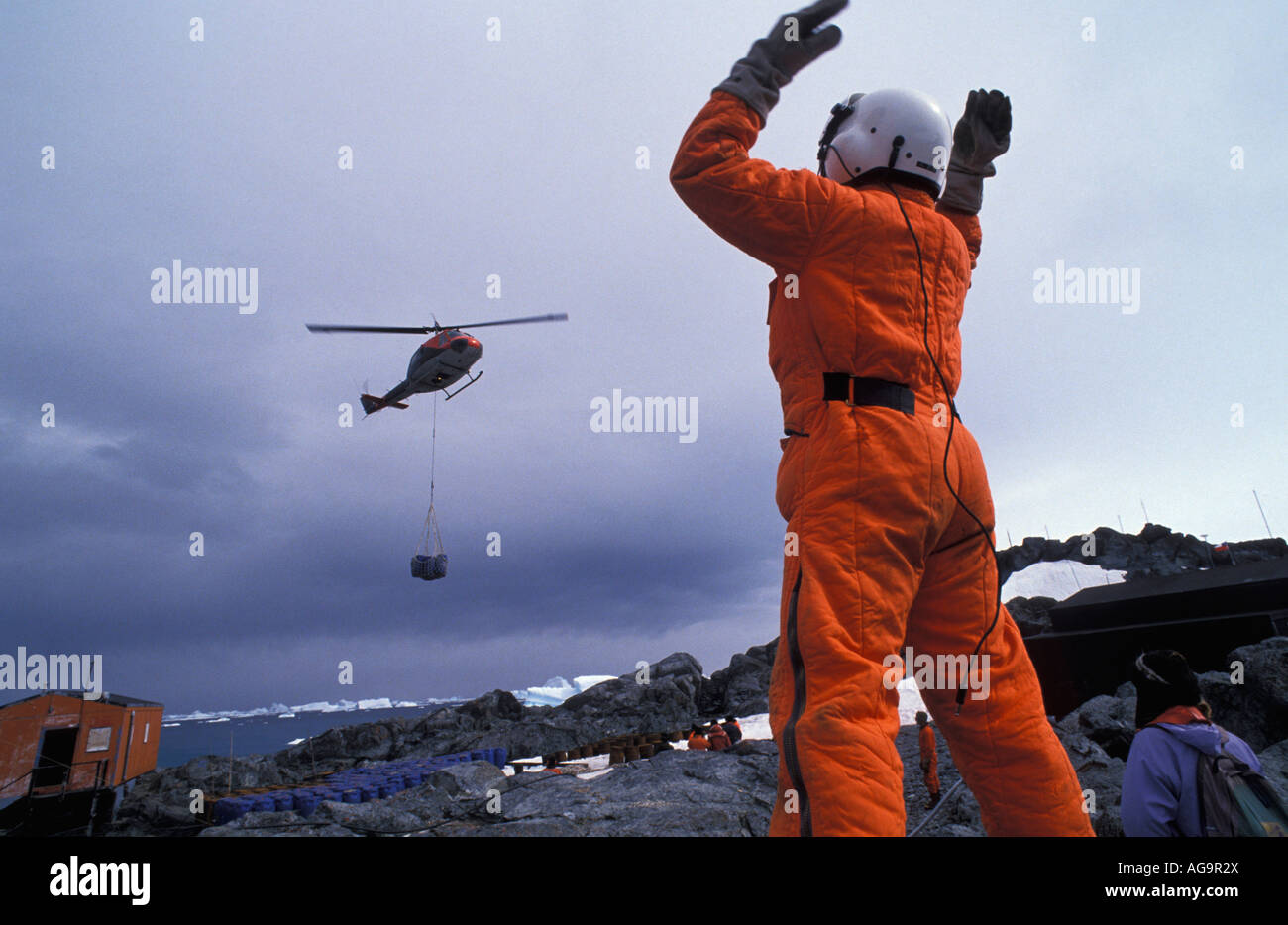 Pilot Carrying Helmet Stock Photos & Pilot Carrying Helmet