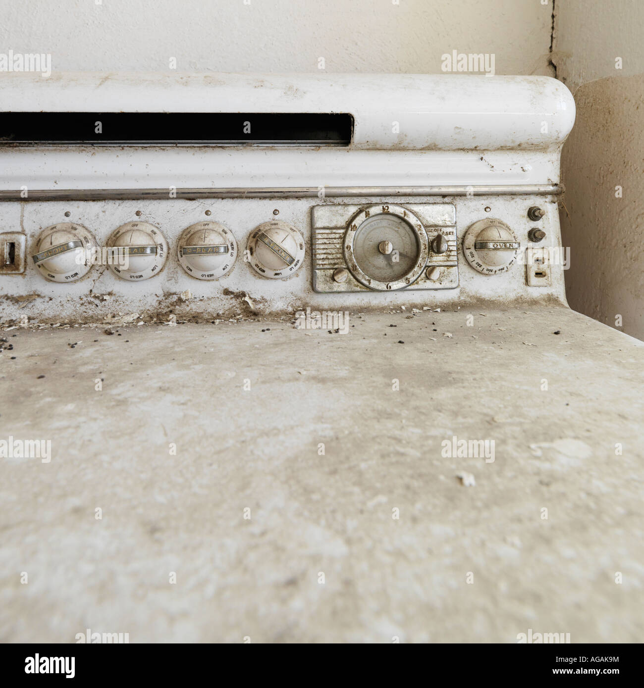 Close up of dirty old antique stove - Stock Image