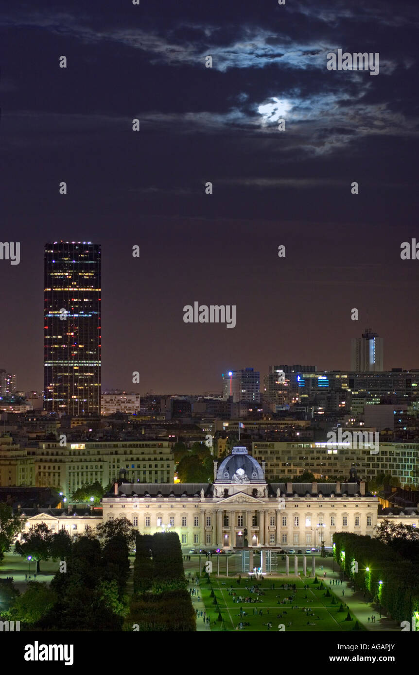 Paris France aerial view of Champs de Mars Montparnasse Tower and Moon at night from Eiffel Tower - Stock Image