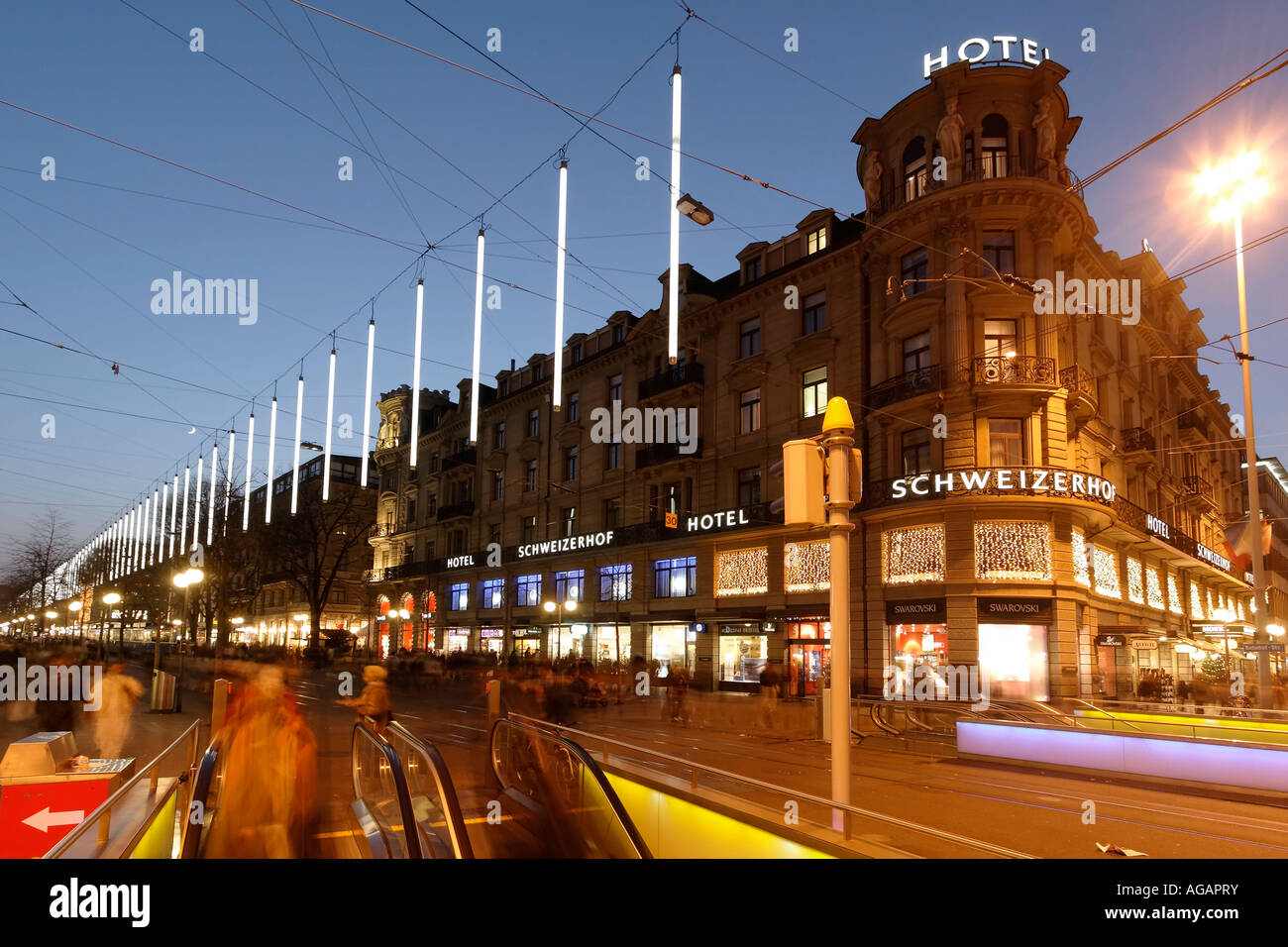 Switzerland Zurich Bahnhofstrasse at twilight Chistmas illumination Hotel Schweizer Hof - Stock Image