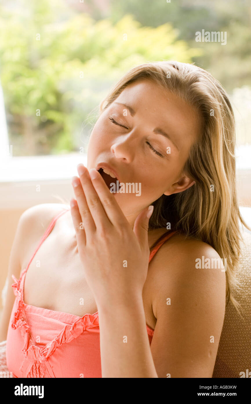 Girl yawning Stock Photo