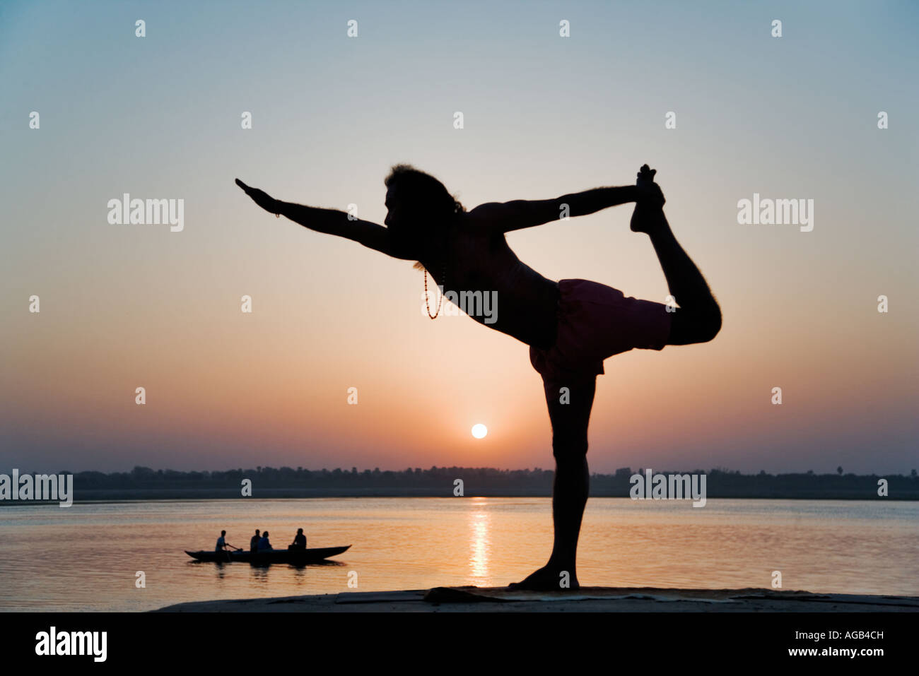 World famous yogi teacher Dr Rakesh Yogi at sunrise over the Ganges River India Stock Photo