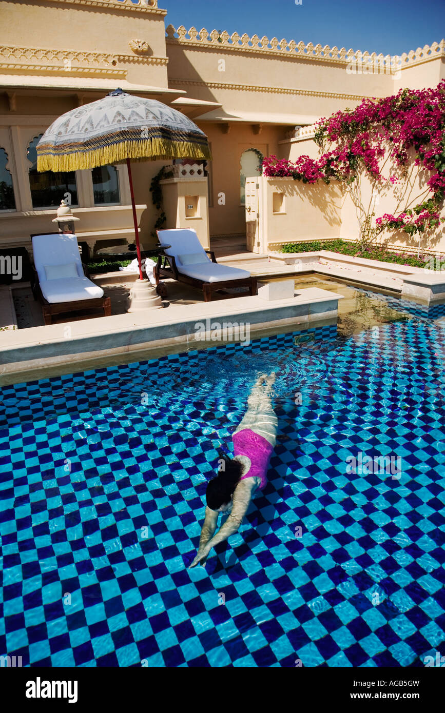 Tourist enjoying a swim in the semi private pool of the ...