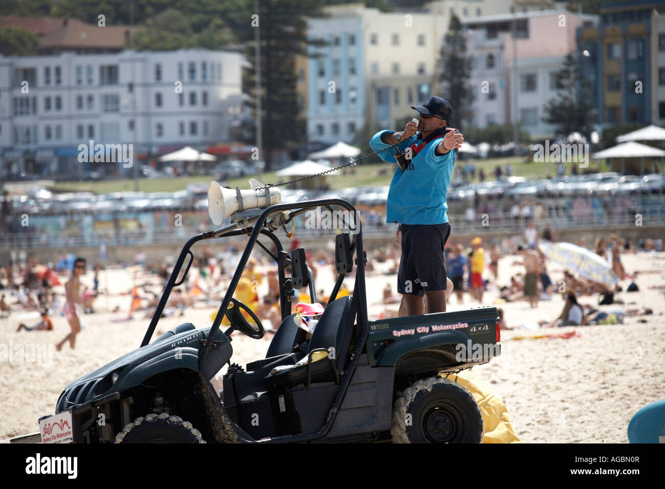 Surf rescue lifeguard calling swimmers on load hailer on Bondi Beach Sydney New South Wales NSW Australia - Stock Image