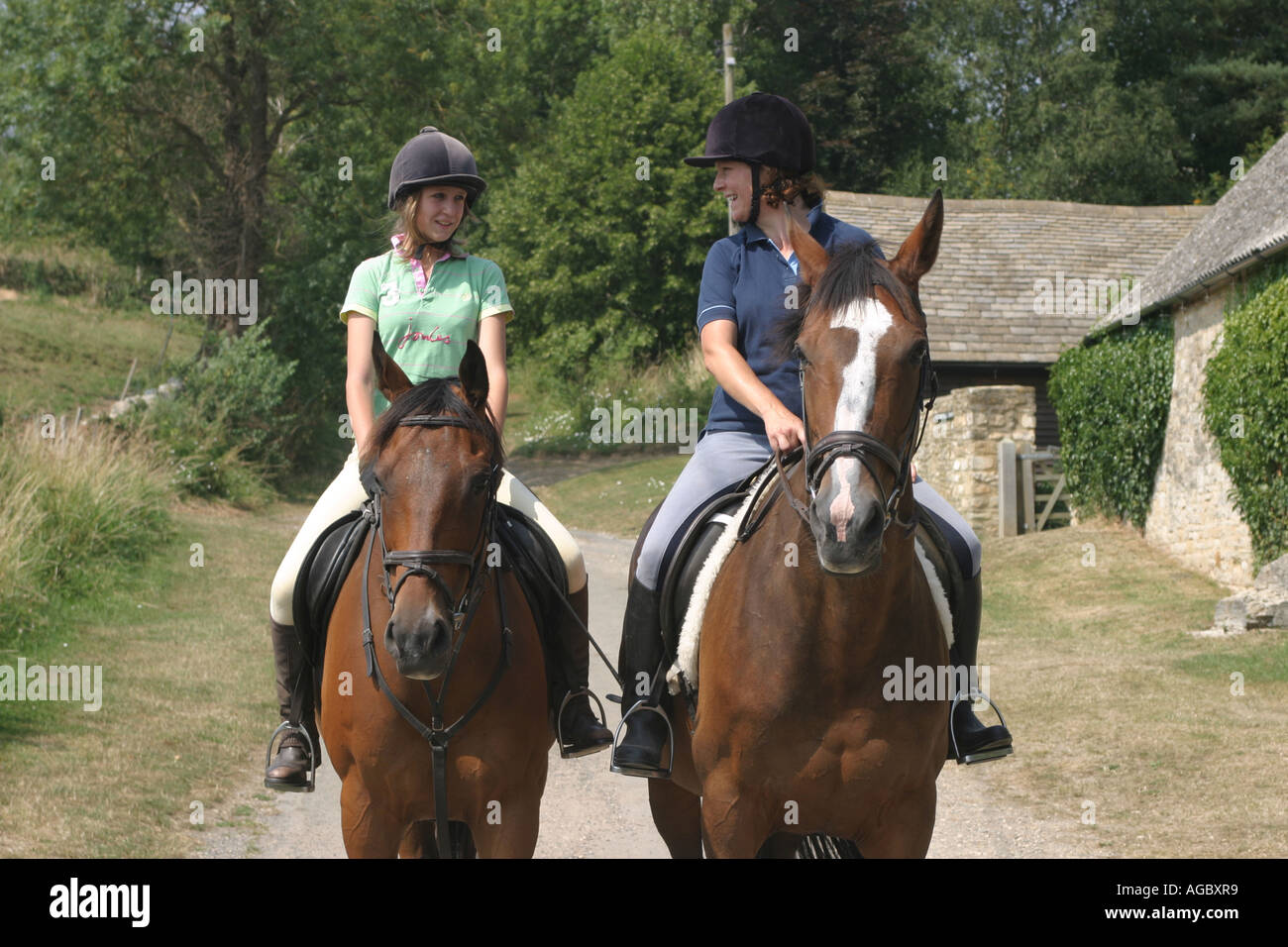 A mother and daughter horse riding in the English countryside. - Stock Image