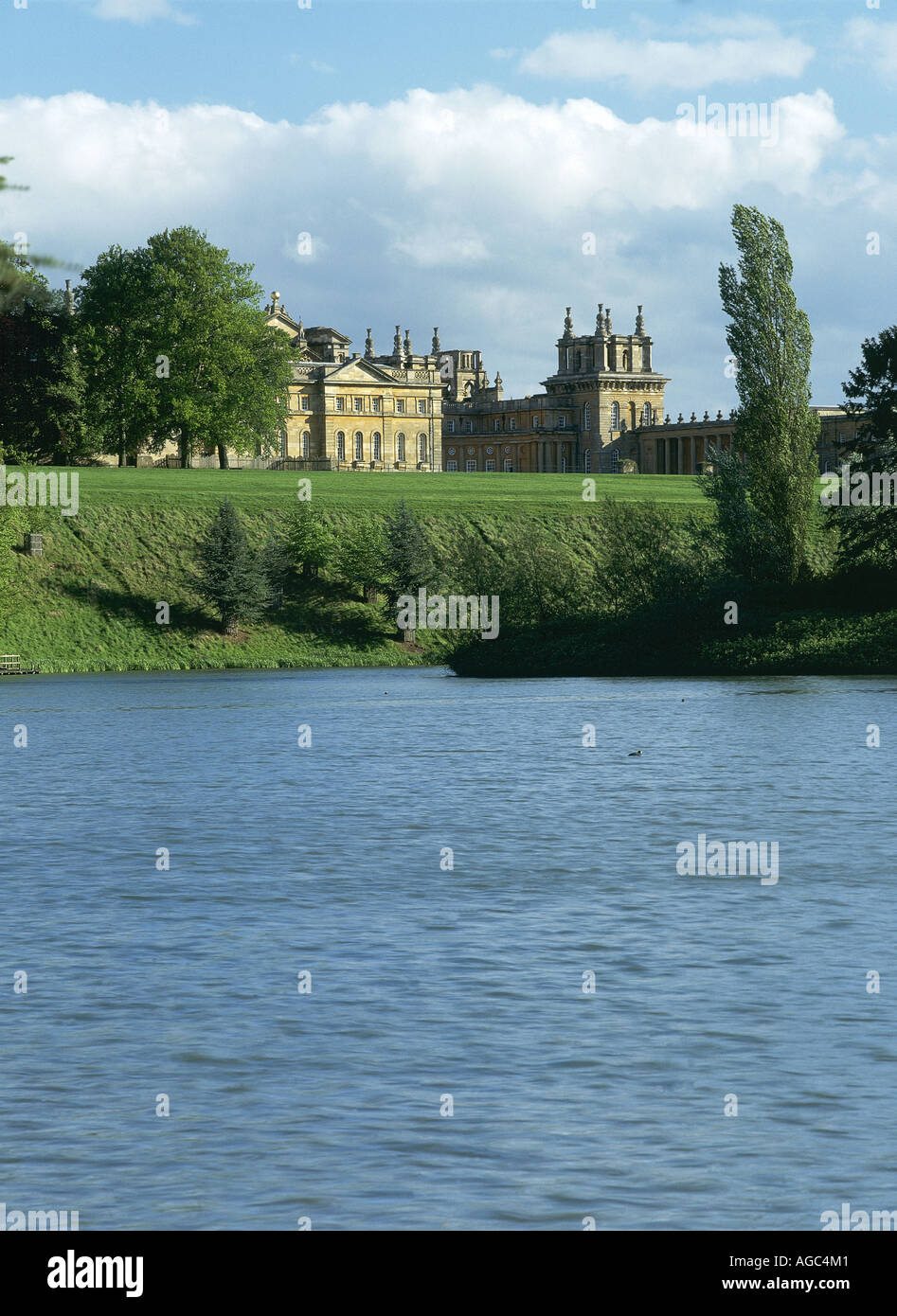 View across the lake to the stately home of Blenheim Palace Designed by Sir John Vanbrugh and Nicholas Hawksmoor given by Queen Anne to John Churchill first Duke of Marlborough 1650 1722 - Stock Image