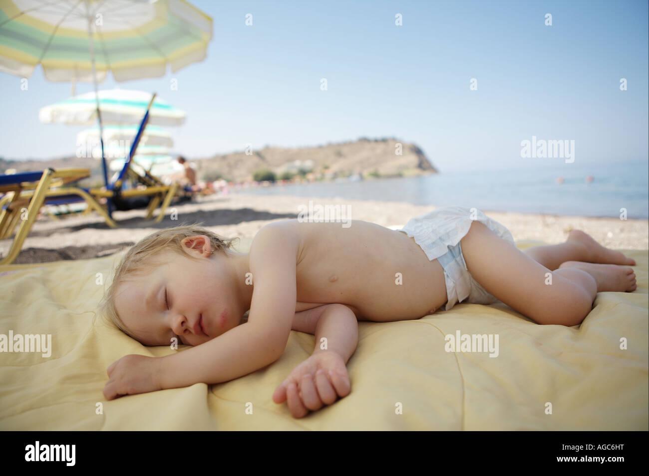Baby sleeping on the beach Summer holiday Lesbos island ...