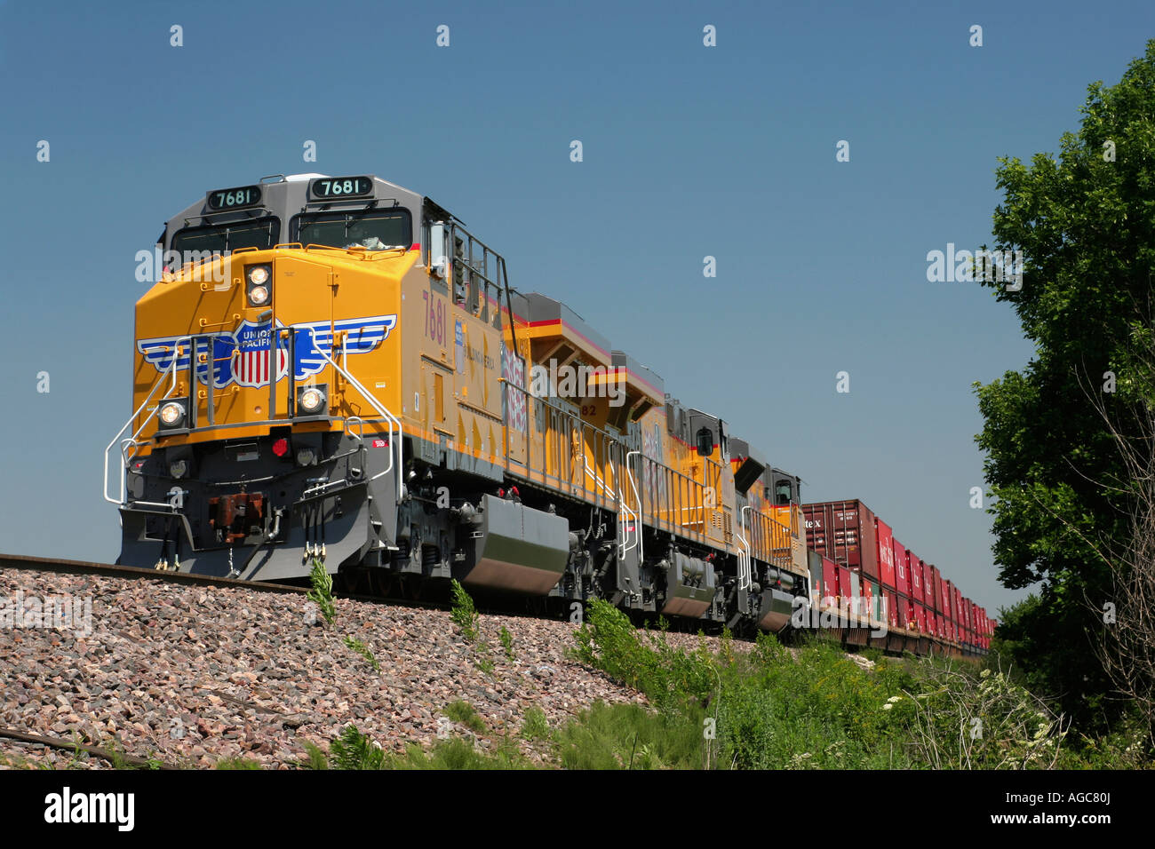 Union Pacific Locomotive And Train Wait On A Siding Near