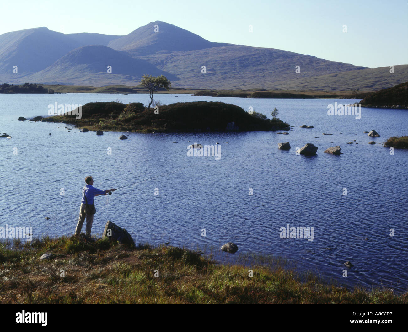 dh Lochan na h Achlaise RANNOCH MOOR LOCH ARGYLL SCOTLAND Angler casting fly fishing line freshwater lake Highlands uk angling mountain Stock Photo