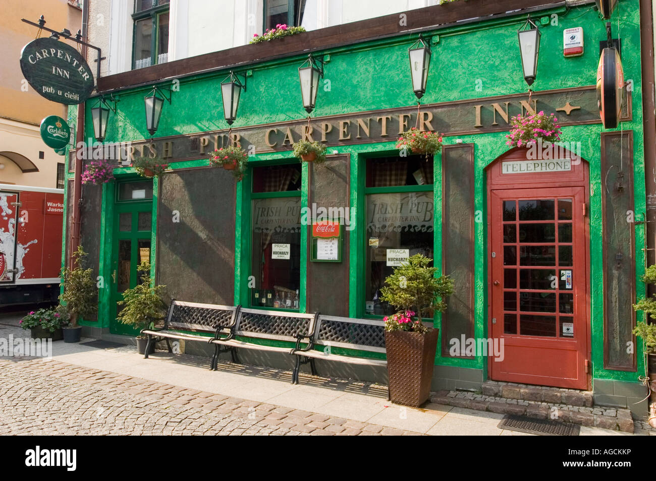 Green Irish Pub The Carpenter Inn in  Olsztyn Allenstein Masuria Poland - Stock Image