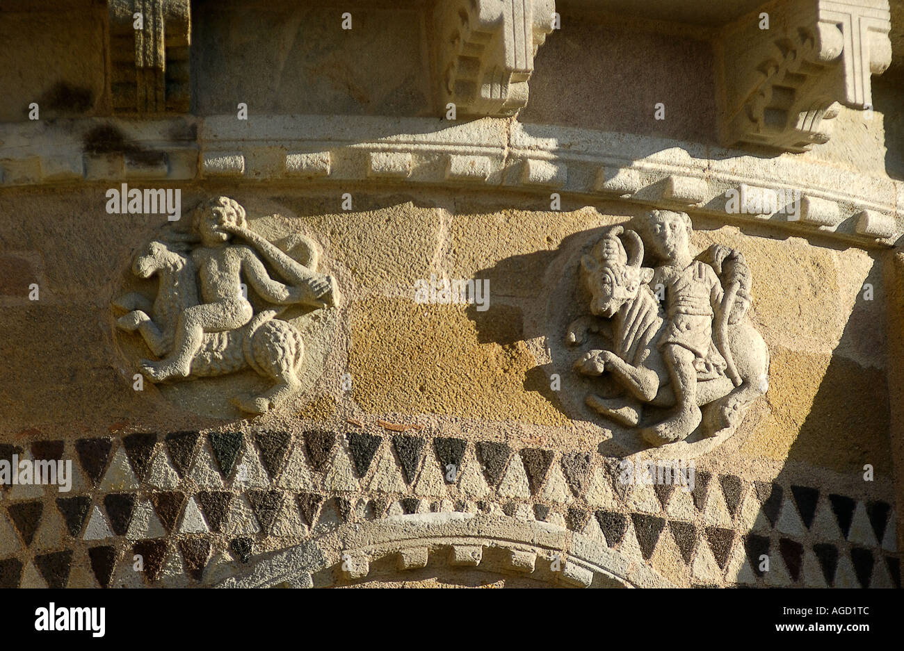 Zodiac sign carving on the Romanesque church of Saint-Austremoine d'Issoire, Issoire, Auvergne, France, Europe - Stock Image