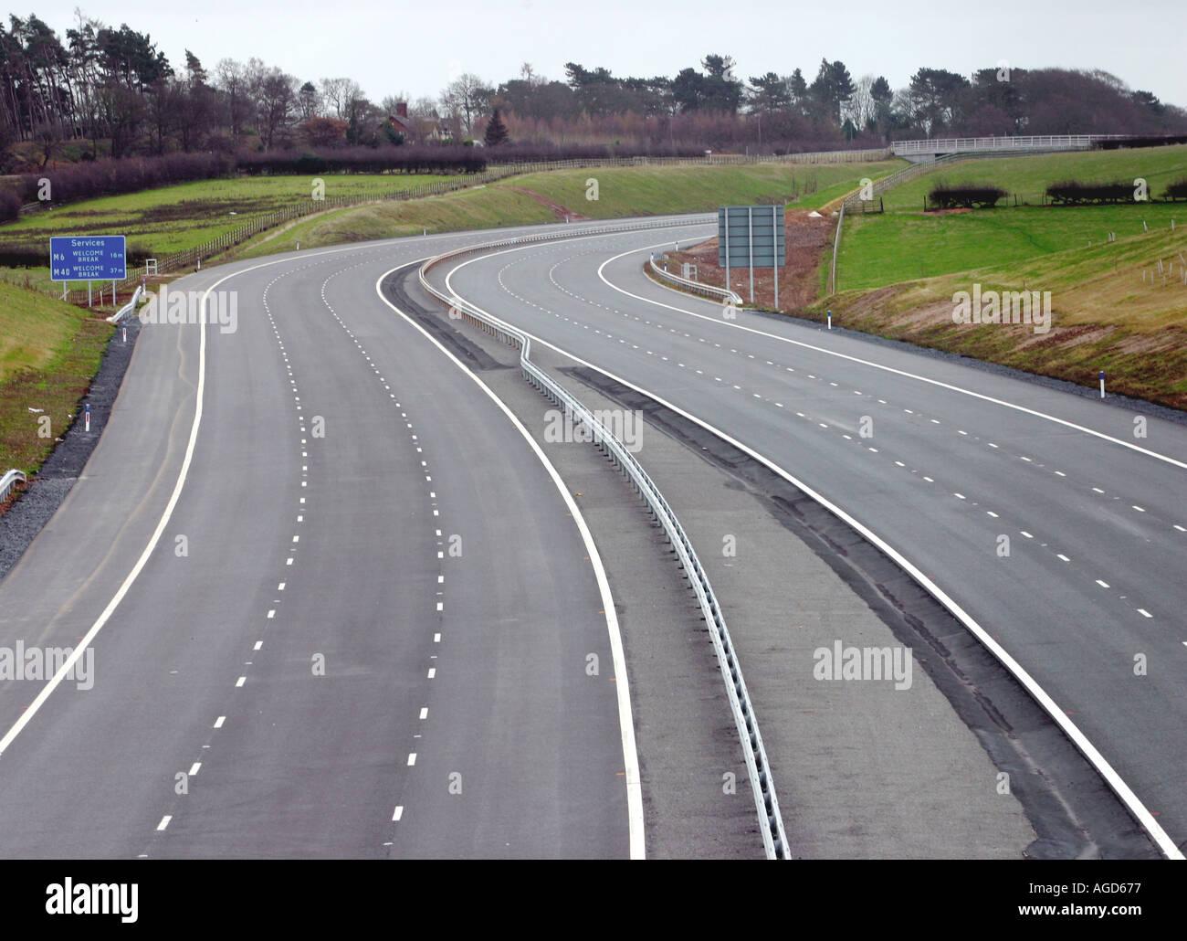 Empty motorway, no traffic. M6 toll road motorway, empty of traffic. - Stock Image
