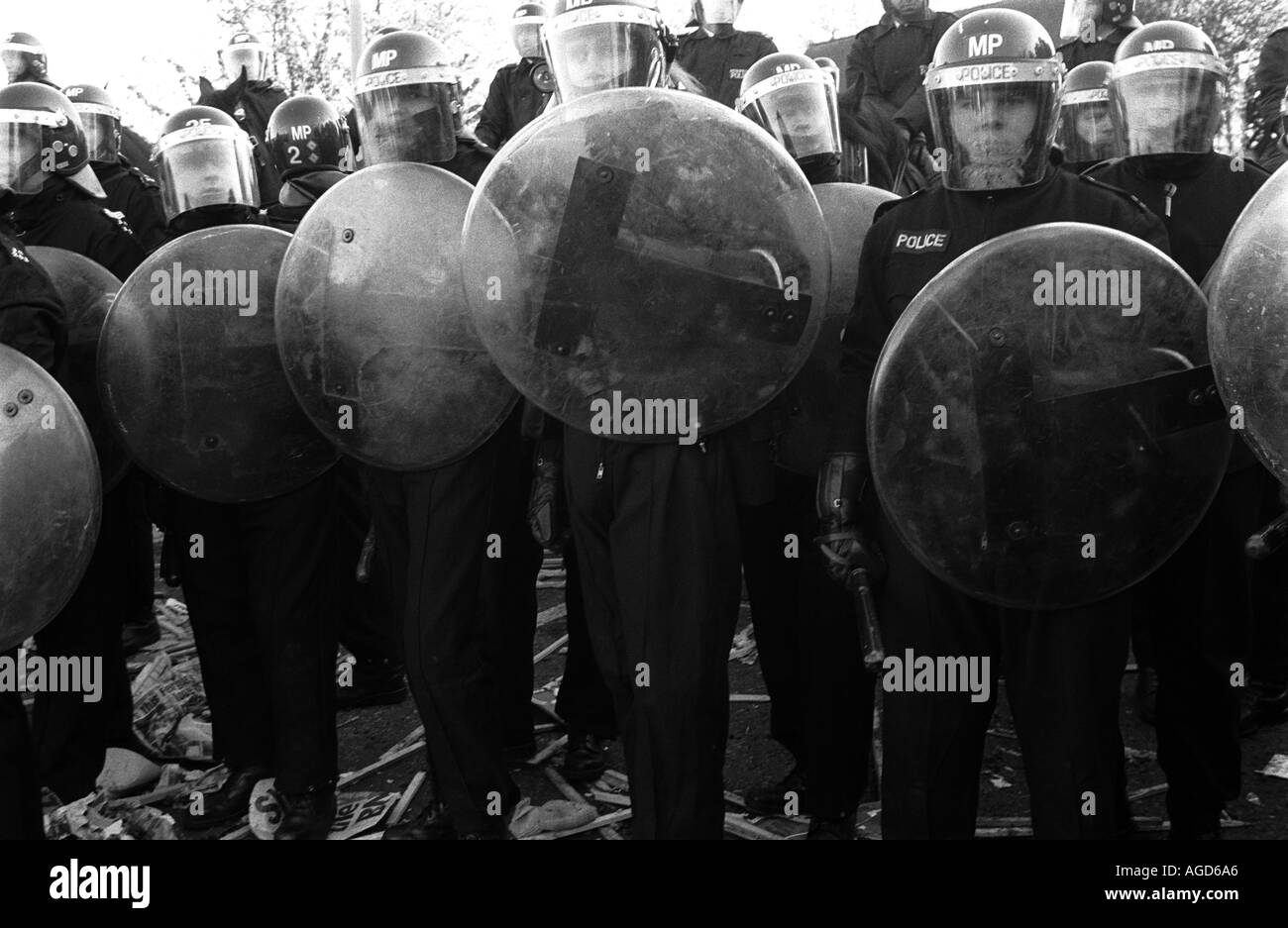 Riot police confront protestors at Welling, London, UK, who tried to march past the headquarters of the British National Party. - Stock Image