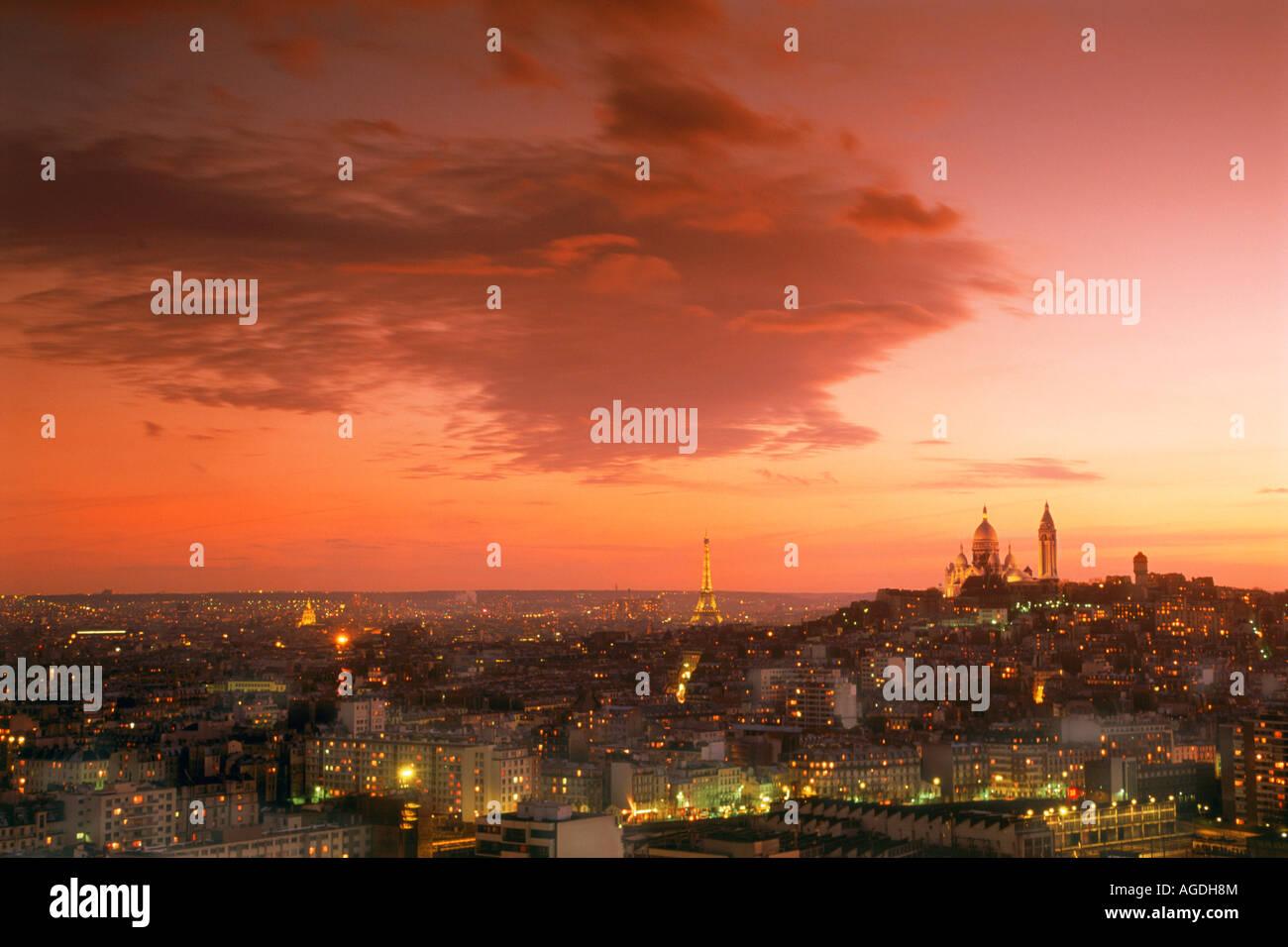 Sacre-Coeur and Eiffel Tower above Paris skyline at dusk Stock Photo
