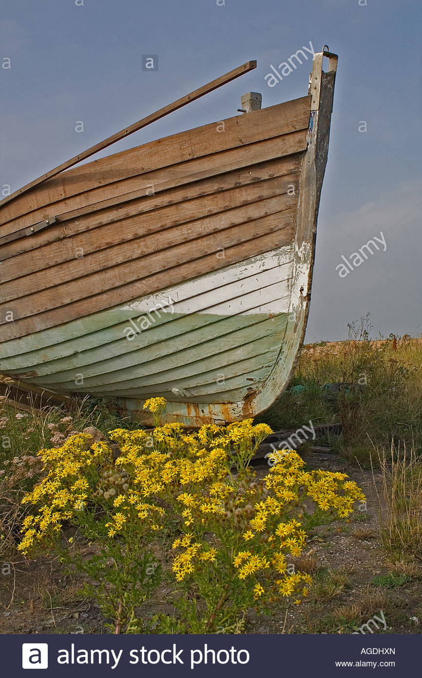 Abandoned fishing boat left to decay on waste ground