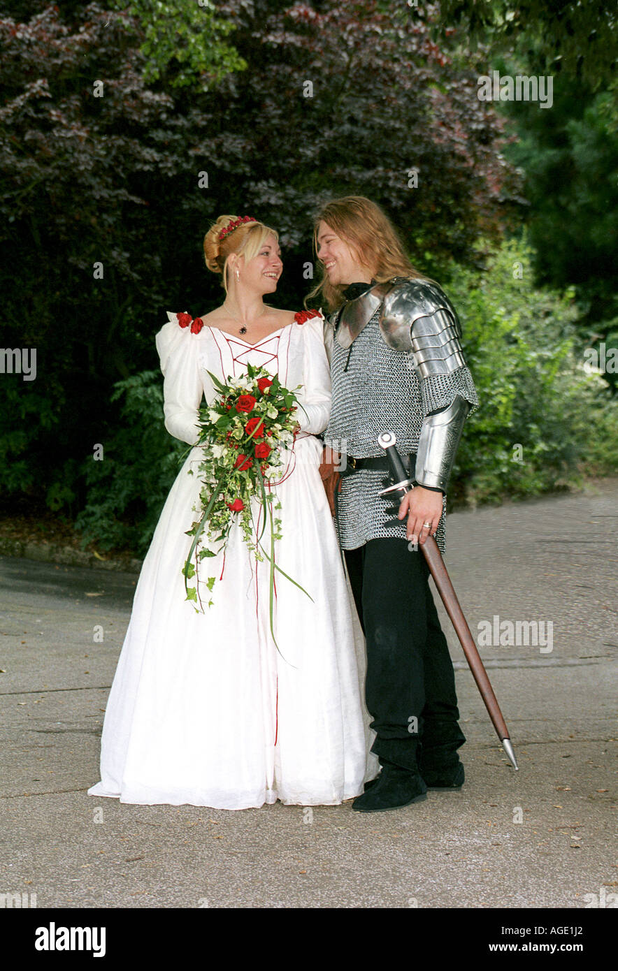 Bride and her 'knight in shining armour' - Stock Image