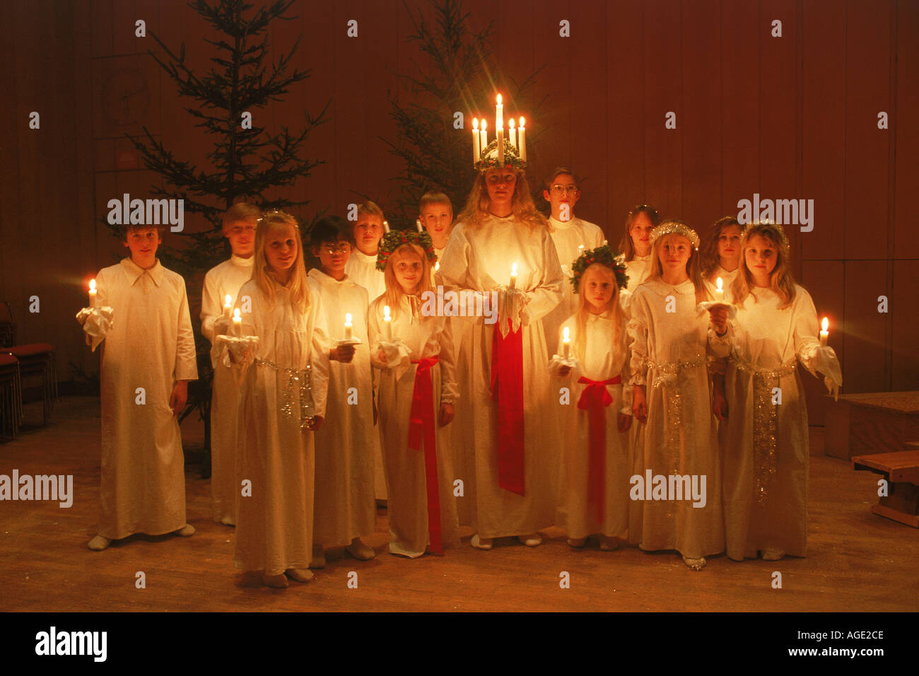 Choir of children with candles on Saint Lucia Day in Sweden - Stock Image