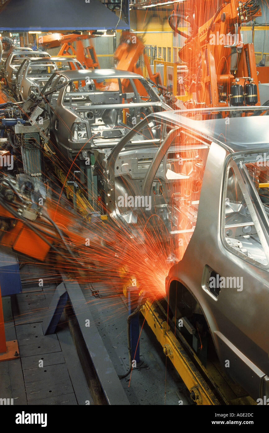 Sparks flying from robatic spot welding at SAAB Scania plant in Sweden - Stock Image