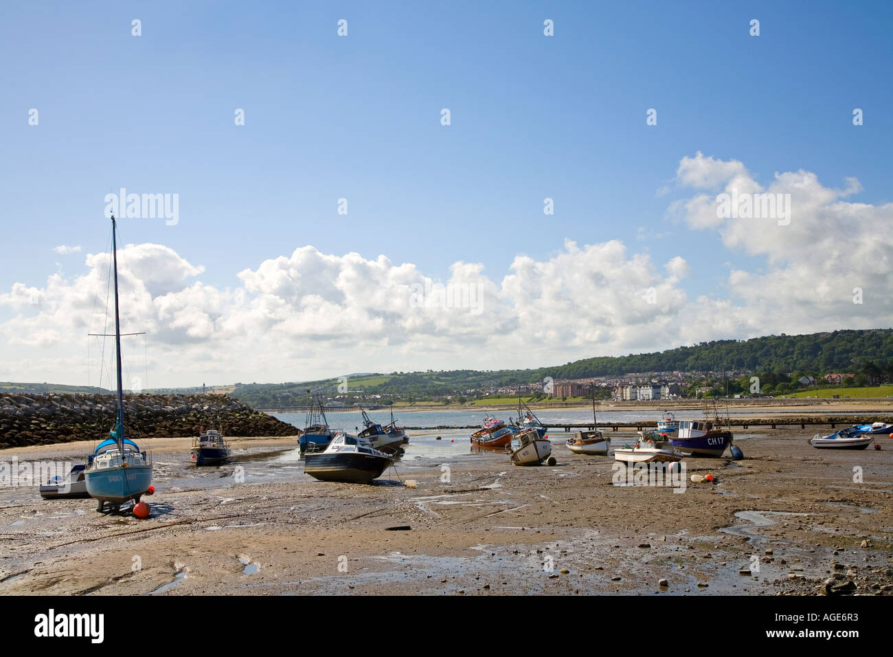 Boats on the beach at low tide Rhos on Sea Conwy Wales UK Stock Photo