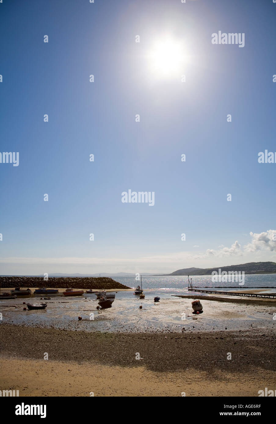 Boats on the beach at low tide Rhos on Sea Conwy Wales UK - Stock Image