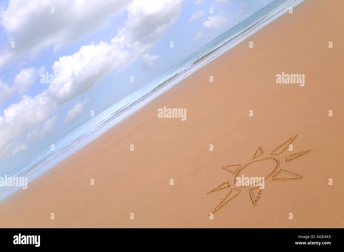 Sun drawing in the sand on a beautiful golden beach Stock Photo