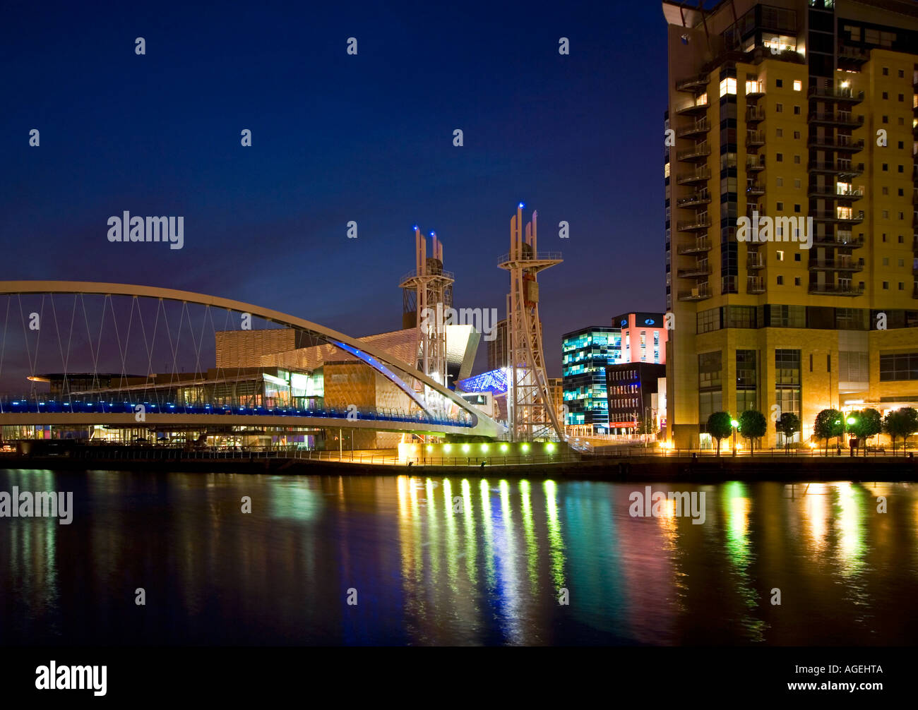 The Lowry Centre, Imperial Point Building and Swingbridge at Night, Salford Quays, Greater Manchester, England, UK - Stock Image