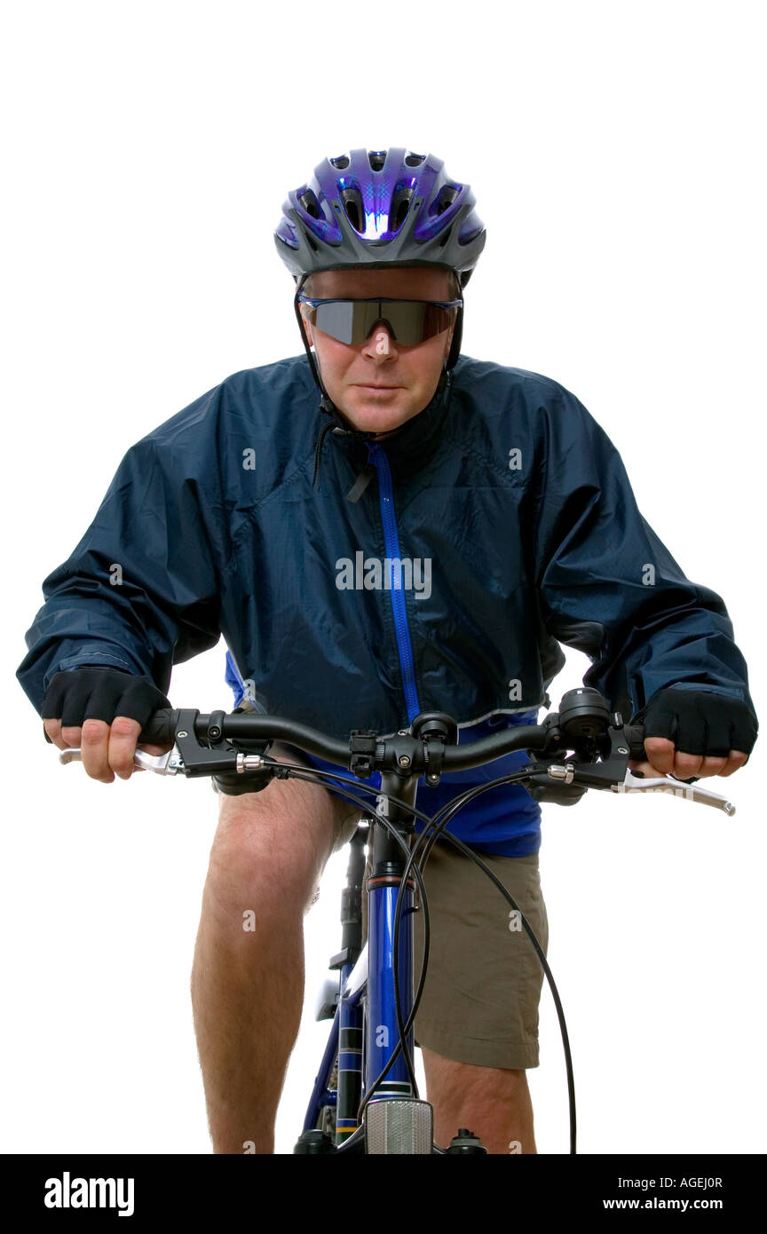 Man riding towards you on a mountain bike Isolated on white high key shot - Stock Image