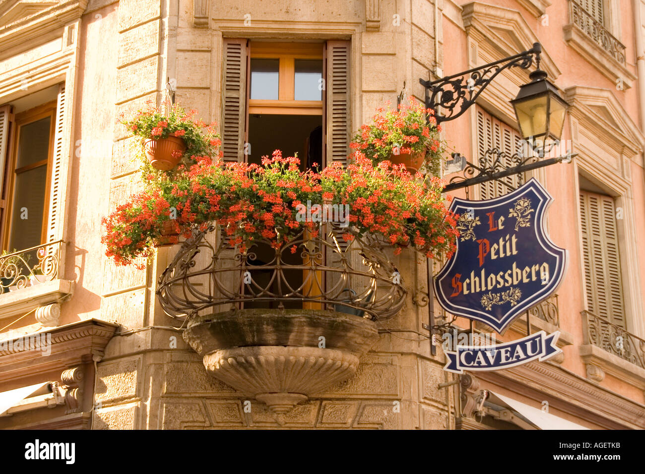 Apartment Balcony With Flowers And A Wine Shop Hanging Sign In Colmar Haut Rhin Alsace France