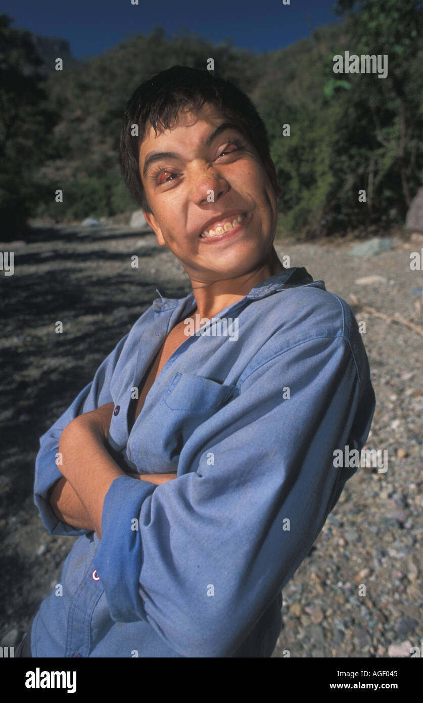 Boy pulling face Copper Canyon Mexico - Stock Image