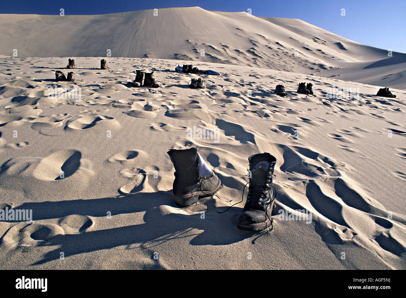 Boots at Eureka Dunes Death Valley National Park California USA - Stock Image