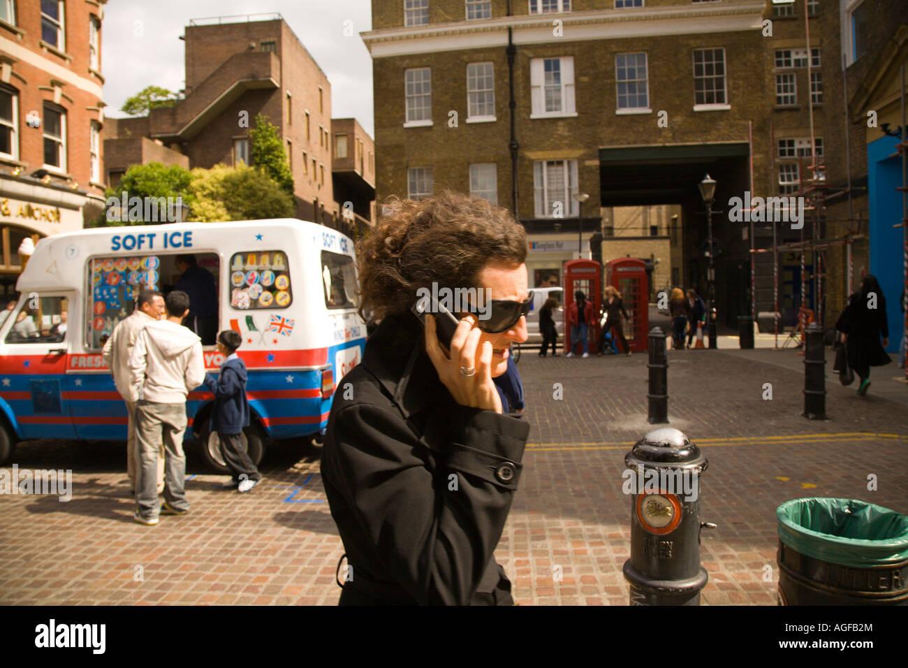 women on telephone in Covent Garden, London - Stock Image