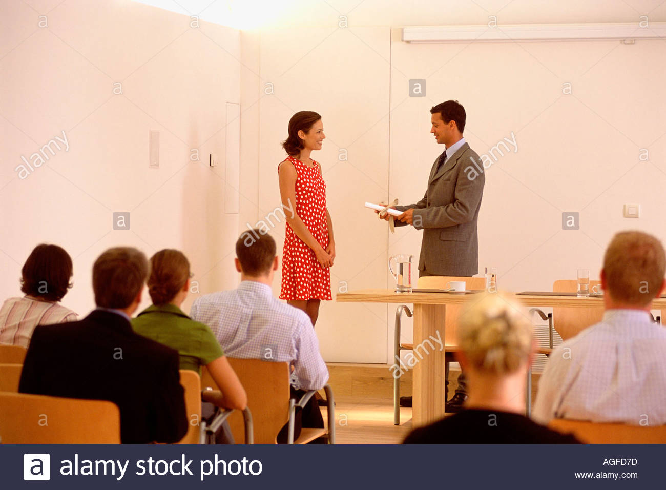 Woman presented a certificate Stock Photo