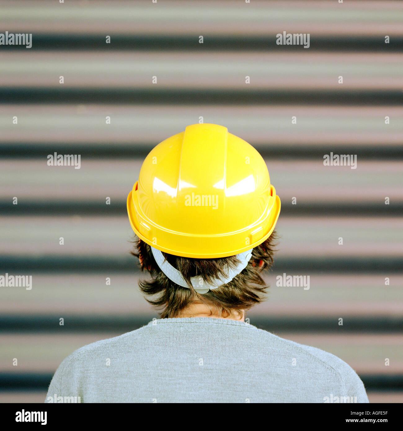 Man wearing a hard hat - Stock Image