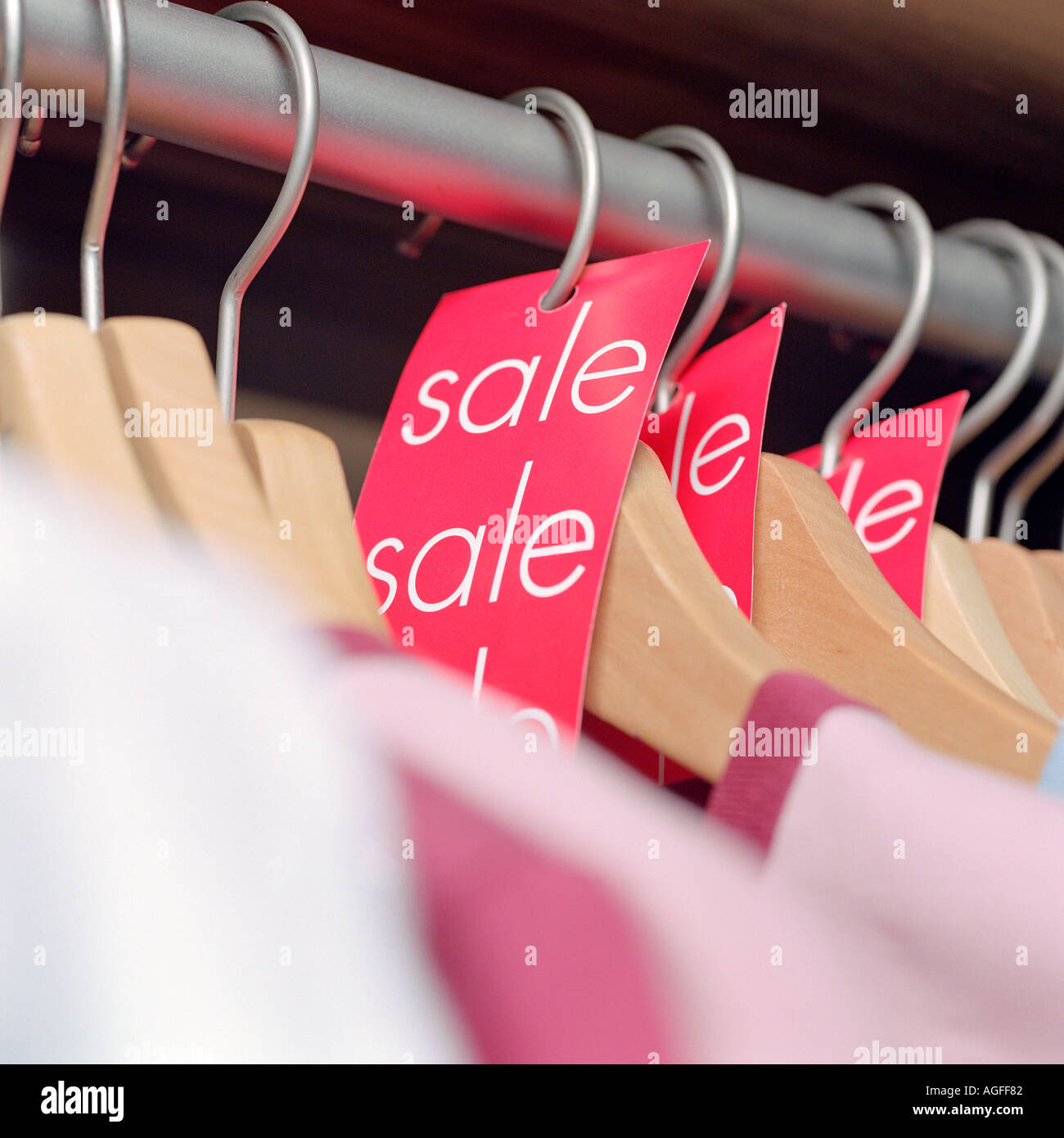 Sale labels on clothes hangers - Stock Image