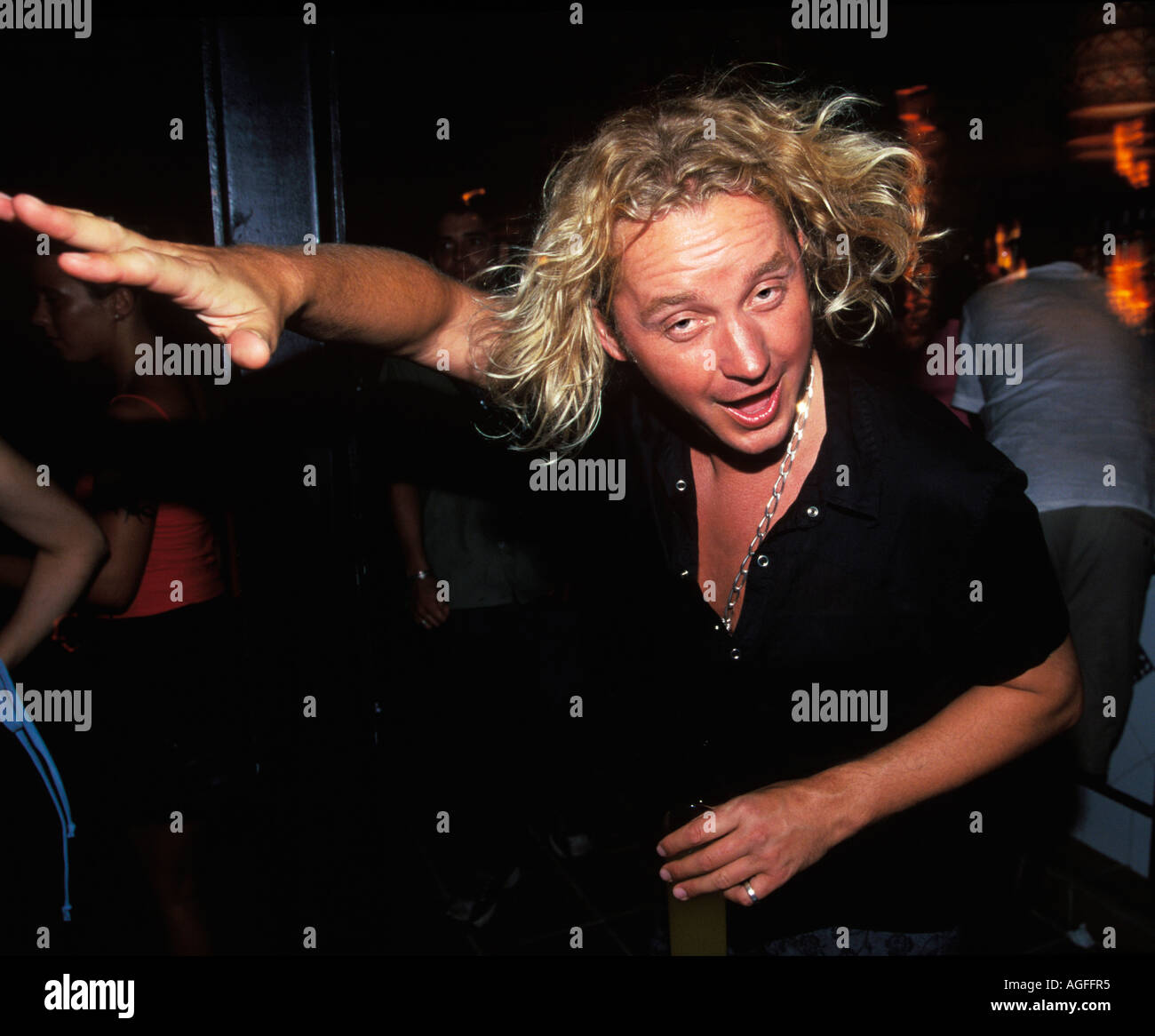Happy man at Gods Kitchen at Amnesia in Ibiza - Stock Image