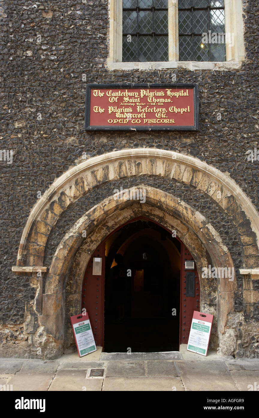 SIGN AND ENTRANCE DOOR TO THE CANTERBURY PILGRIMS HOSPITAL OF SAINT THOMAS CANTERBURY KENT ENGLAND - Stock Image