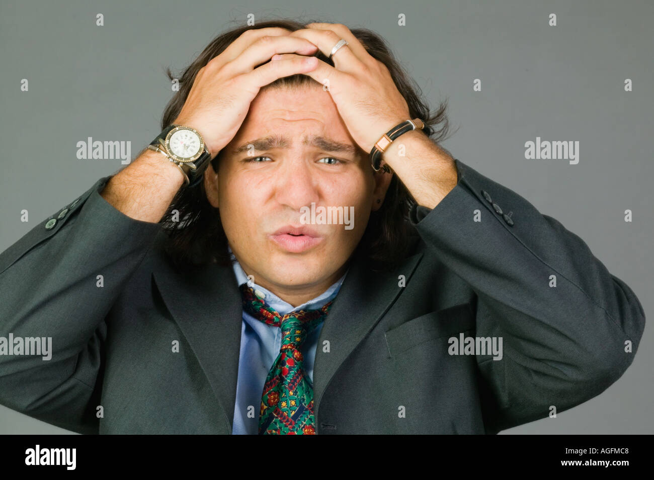 Young Latino businessman exasperated like he forgot something - Stock Image