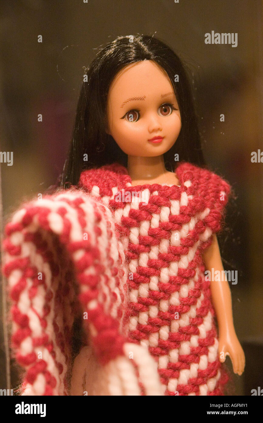 Close Up Photo Of A Barbie Doll Dressed In Traditional Salish Indian Woven Clothing