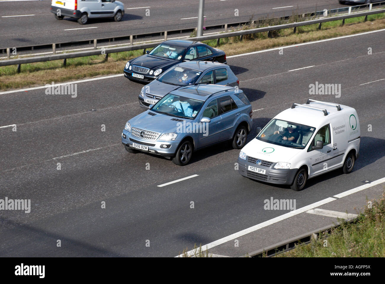 cars in a line on the motorway - Stock Image
