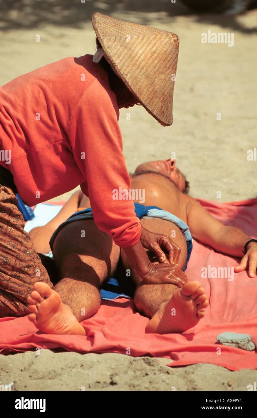 tourist having beach massage, Phuket, Thailand Stock Photo